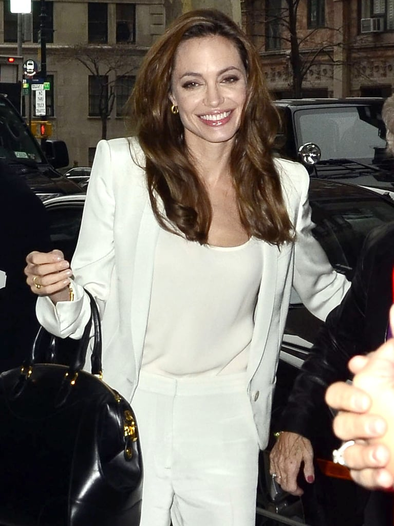 Angelina Jolie was all smiles arriving for an early morning interview.