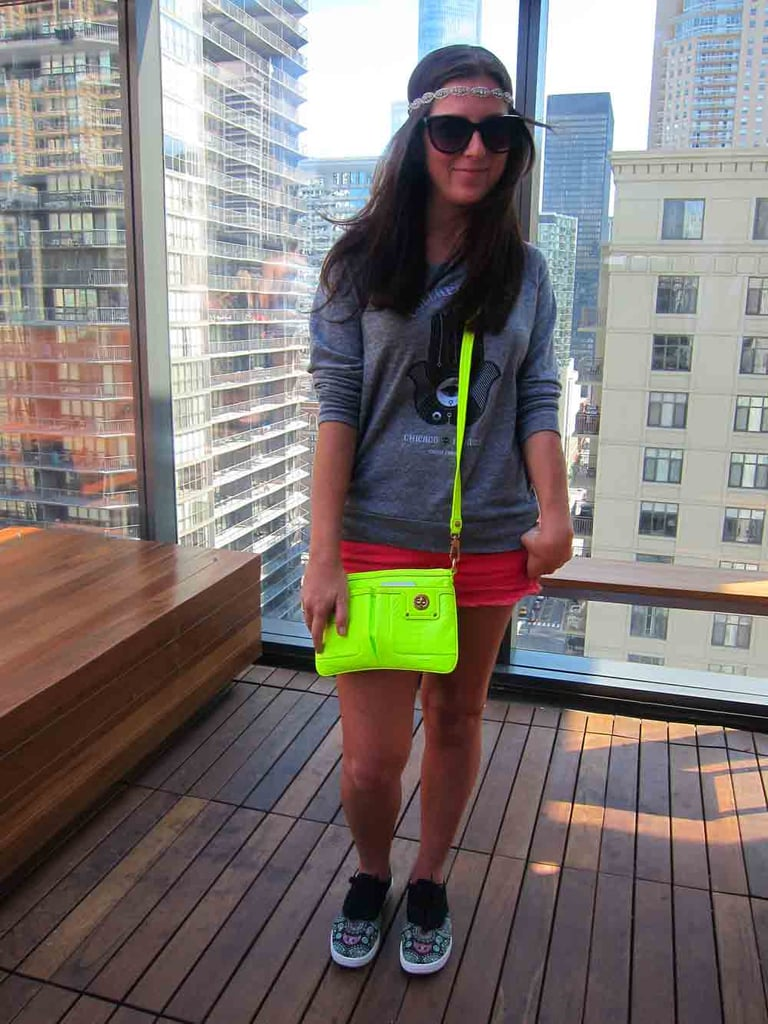 At a MAC Lollapalooza rooftop party, Katie showed how much fun it is to wear festival merchandise. She paired her sweatshirt with a neon yellow Marc by Marc Jacobs bag and BucketFeet owl-print shoes.