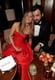 Jennifer Aniston cuddle up to fiancé Justin Theroux at Vanity Fair's Oscar after-party.