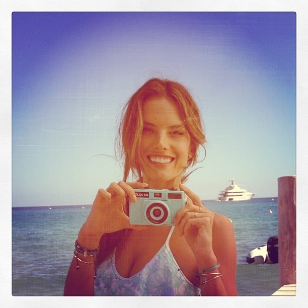 Alessandra Ambrosio snapped photos with a cute camera on the beach. Source: Instagram user alessandraambrosio