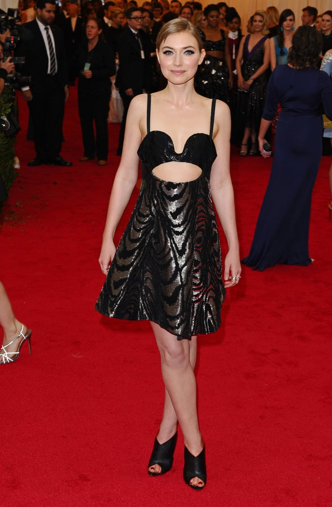 At the 2014 Met Gala, Imogen showed off her stomach in a Proenza Schouler cutout dress.