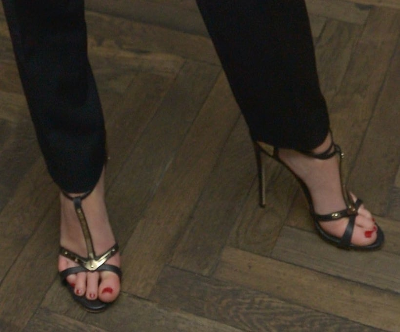 Jennifer Lawrence completed her tuxedo-inspired getup via black-and-gold T-strap sandals at the Weinstein party.