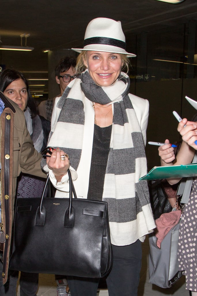 Forget shapeless totes for traveling. Cameron Diaz is another fan of the Sac de Jour's polished shape. Photo courtesy of Saint Laurent