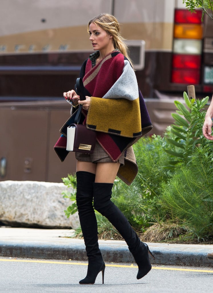 How else would you style a poncho? Olivia amped up the shapeless silhouette with a thigh-high hemline, over-the-knee boots, and a CH Carolina Herrera Casati bag.