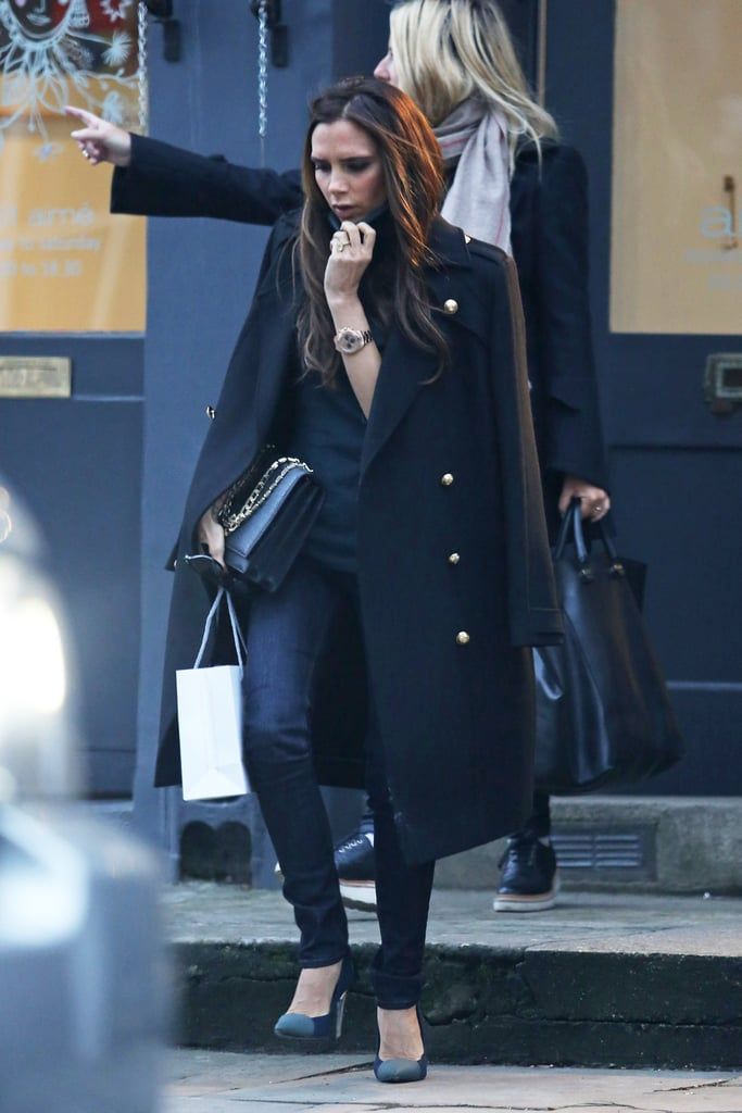 While shopping around London, Victoria Beckham paired her all-black basics with a Victoria Beckham military coat, cap-toe Proenza Schouler pumps, and a chain-strap bag.