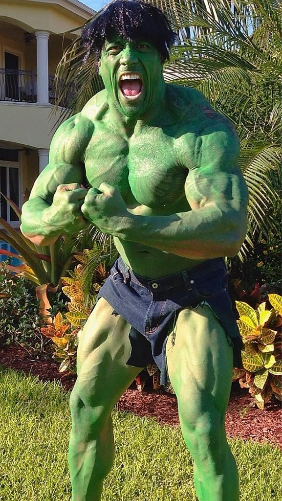 The Rock showed off his major muscles covered in green paint and posing as The Hulk. Source: Twitter user TheRock