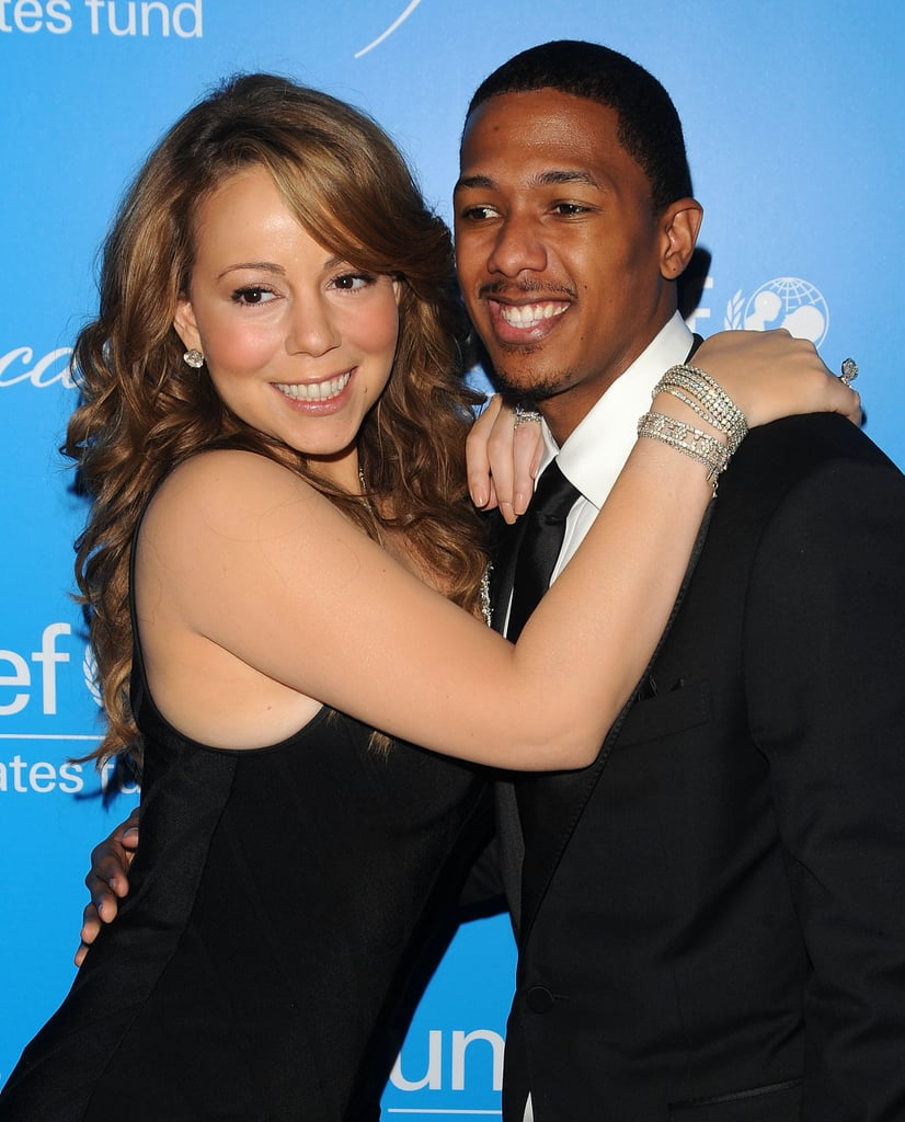 Marish Carey hung onto Nick Cannon at the December 2009 UNICEF Snowflake Ball in NYC.