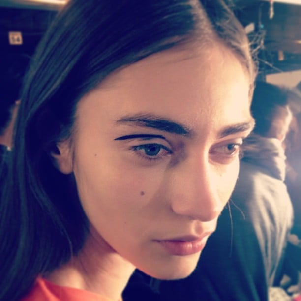 A model at Rag & Bone showed off the graphic eye makeup look sent down the runway: a dark line swept right across the crease.