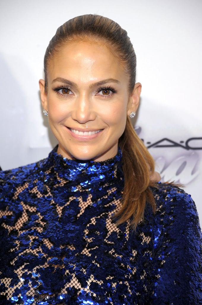 With her ornate neckline, Jennifer Lopez stuck with a simple ponytail and glowing skin.