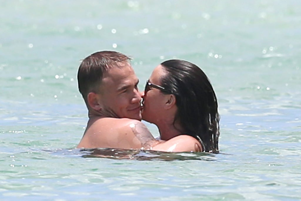 Alanis Morissette Shows Skin — and PDA — in a Bikini