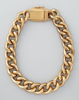 This chunky Tory Burch Charlie Box Chain Necklace ($265) would look amazing on its own or as the anchor to layers of other statement jewels.