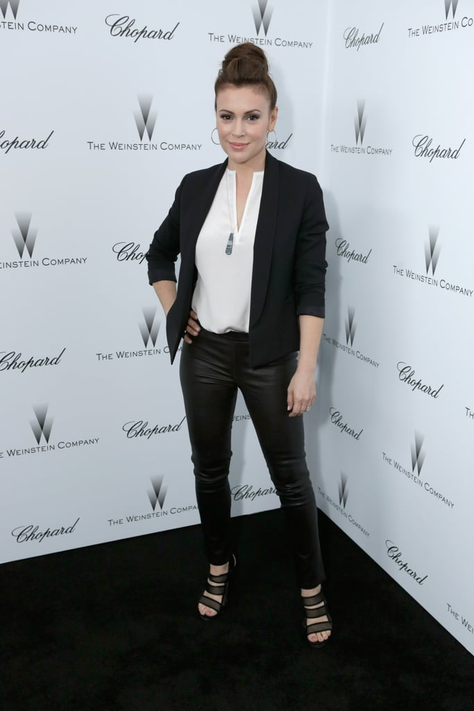 Alyssa Milano sported black leather pants with a white blouse and black blazer for a more laid-back approach to partywear.