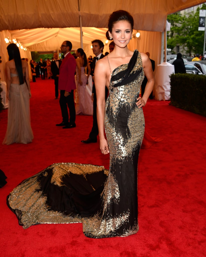 Nina Dobrev wore a showstopping Donna Karan gown.