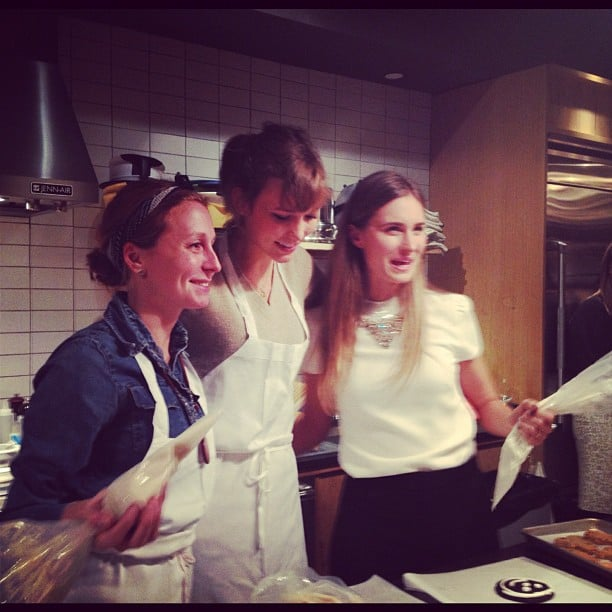 Lauren Bush and Karlie Kloss got ready to frost some cookies at the FEED event.