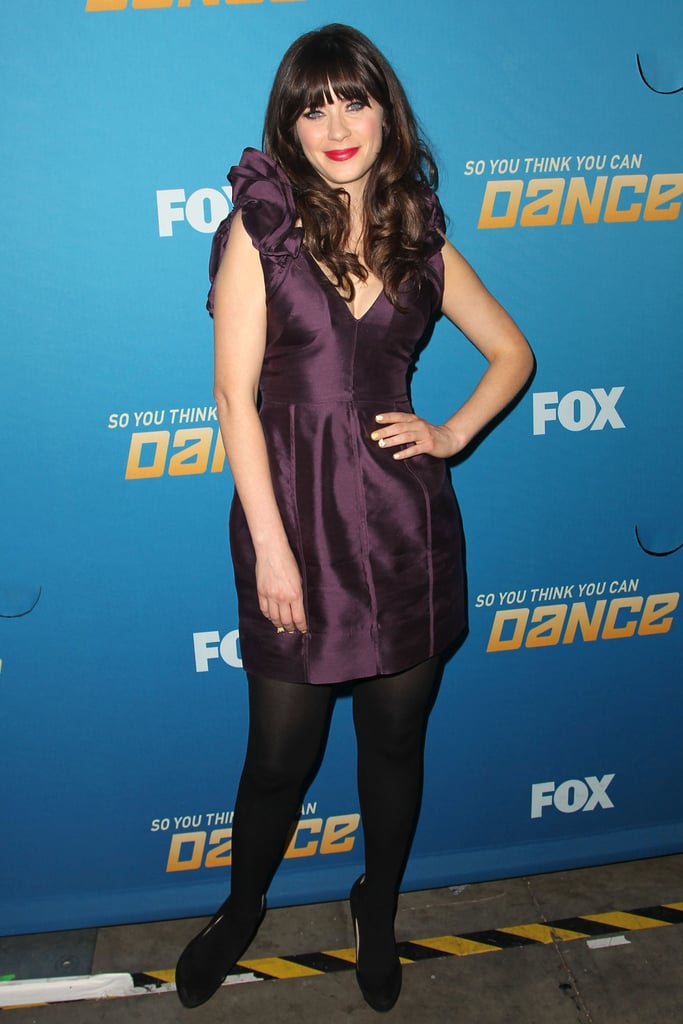 While the flare of this purple Lisa Ho dress may be a little bit more subtle, Zooey kept the volume in check with some serious ruffle on the sleeves.