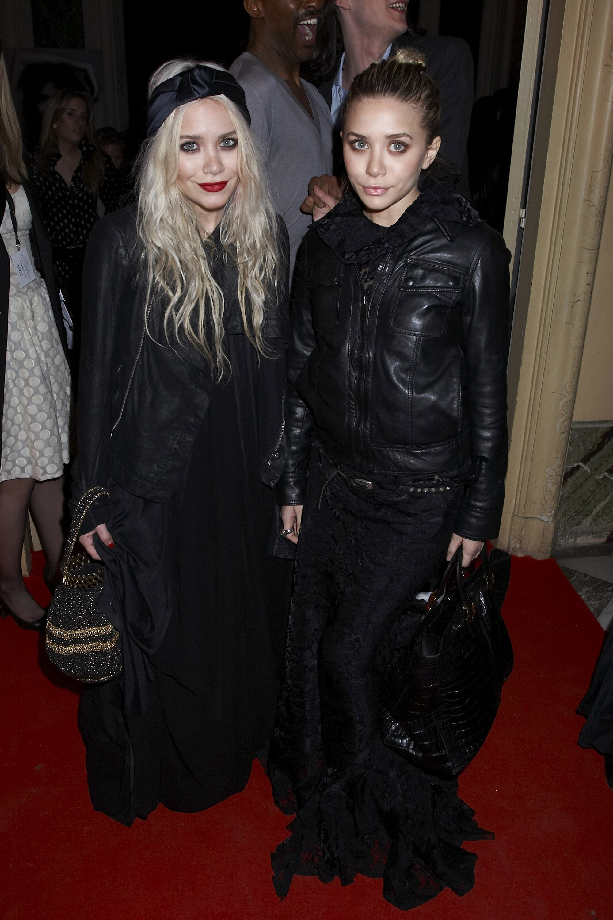 Twinning combo: It was all about leather jackets and black maxis for the Giambattista Valli Fall/Winter 2007 show during Paris Fashion Week.  Mary-Kate finished off her LBG — long black gown — with an open leather jacket, satin turbin, and beaded bag. Ashley zipped her soft leather topper over a dramatic lace gown and toted a black crocodile bag.