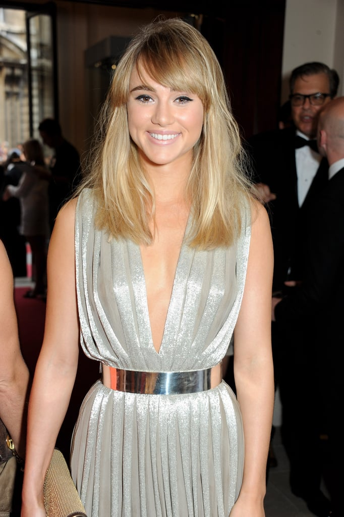 Suki Waterhouse's full bangs fit right in with the rest of her straight hair.