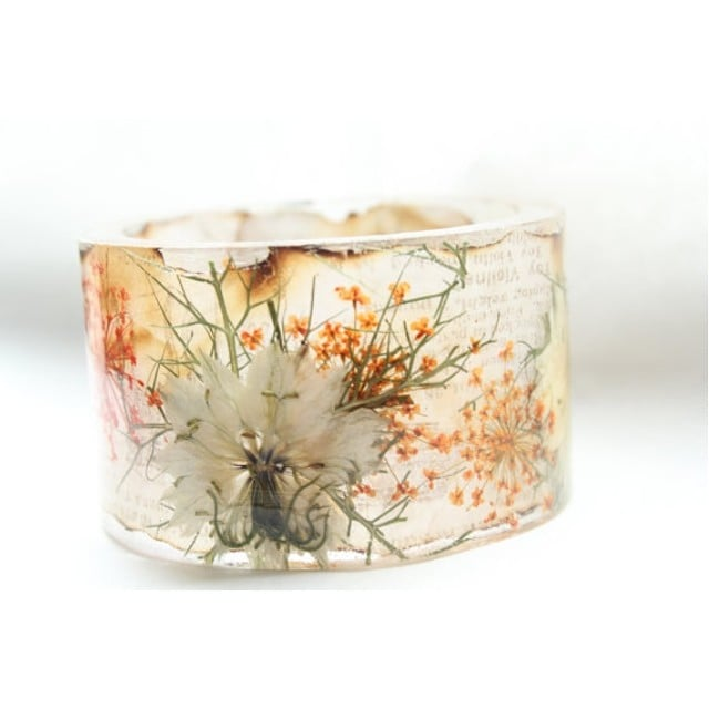 You could also have some of the flowers from your bouquet, the boutonniere, or centerpieces preserved in a bracelet!