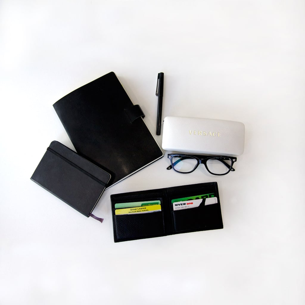 I have many leatherbound books... I buy the same Moleskine diary every December in preparation for the New Year. If I don't write it in my diary, it doesn't happen.  I was recently prescribed glasses and now I can see! My frames are Versace. The larger notebook is for work where I plan my day and take notes at events. The wallet is new, it's from the men's department at County Road, but I am definitely a woman.
