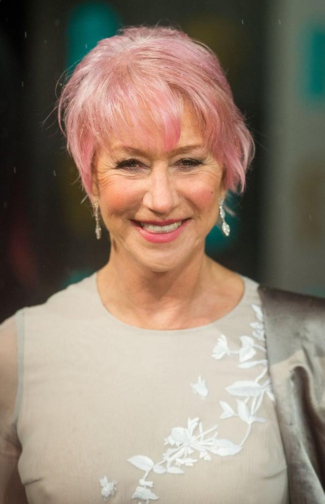 Helen Mirren debuted her new pink hairdo at the BAFTA Awards.