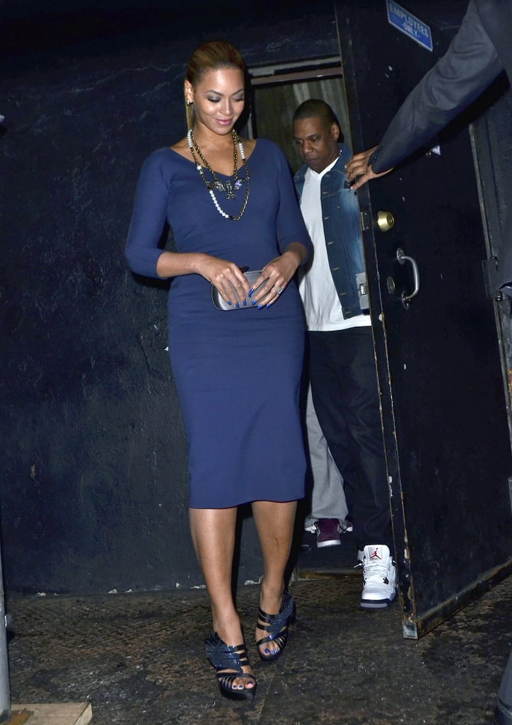 While out in NYC in March 2012, Beyoncé looked classic in a navy Victoria Beckham sheath and Lanvin jewels while Jay Z kept it laid-back in a denim jacket and white sneakers.
