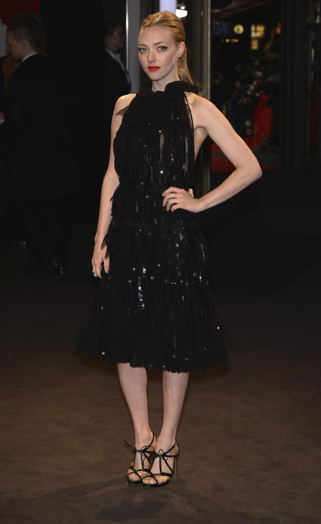 For the Les Misérables premiere in Berlin, Amanda Seyfried chose a little black dress by Nina Ricci that was all about the shine. Cutout Rupert Sanderson heels and red lips completed Amanda's dazzling look.