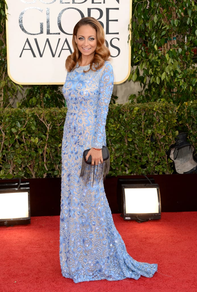 Mom of two Nicole Richie — Harlow, 4, and Sparrow, 3 — made a splash in a long, periwinkle-hued Naeem Khan gown.