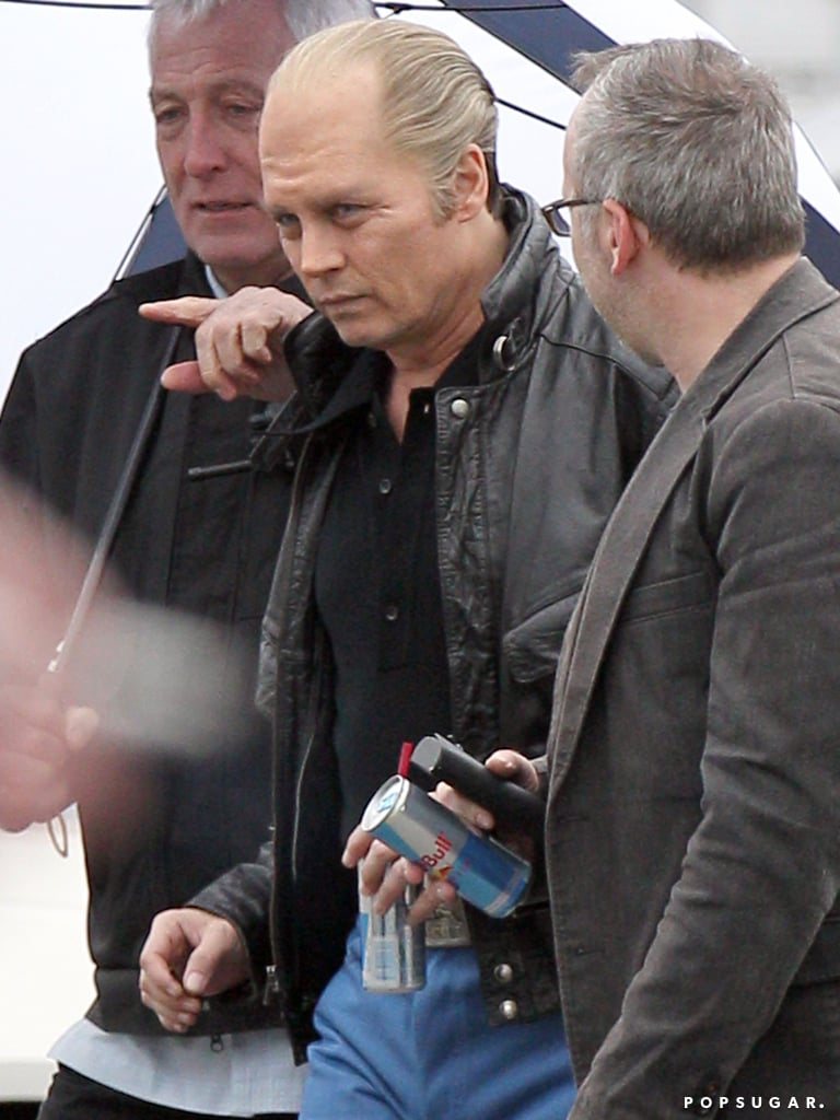 Johnny donned a black leather coat to film scenes in Boston in May.
