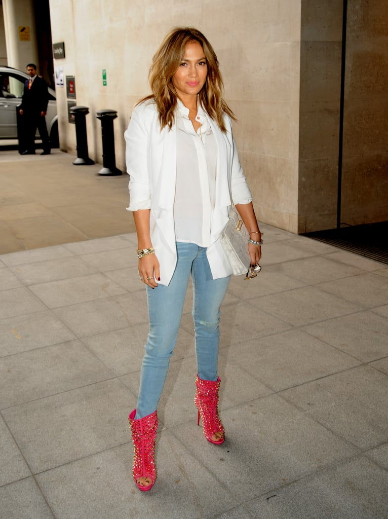 A more casual Jennifer Lopez hit the street in white on white — accented with some studded, slouchy peep-toe ankle boots.