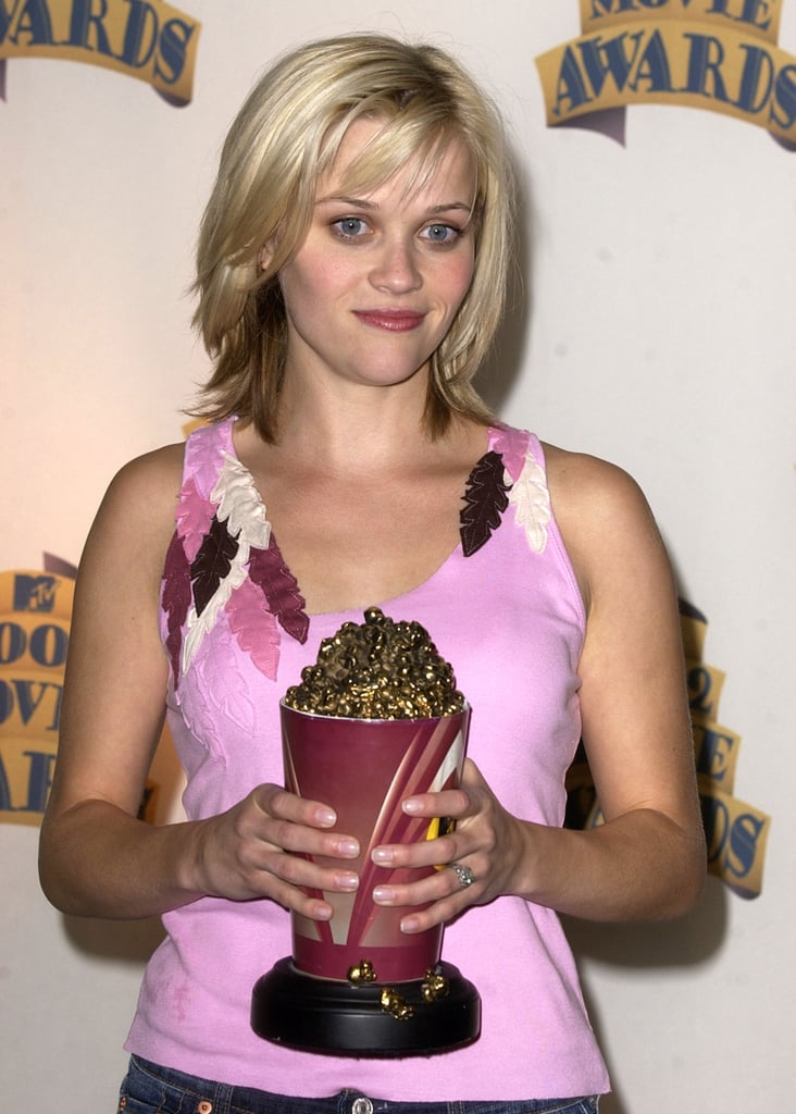 Reese Witherspoon posed with her golden popcorn in the press room at the 2002 awards.