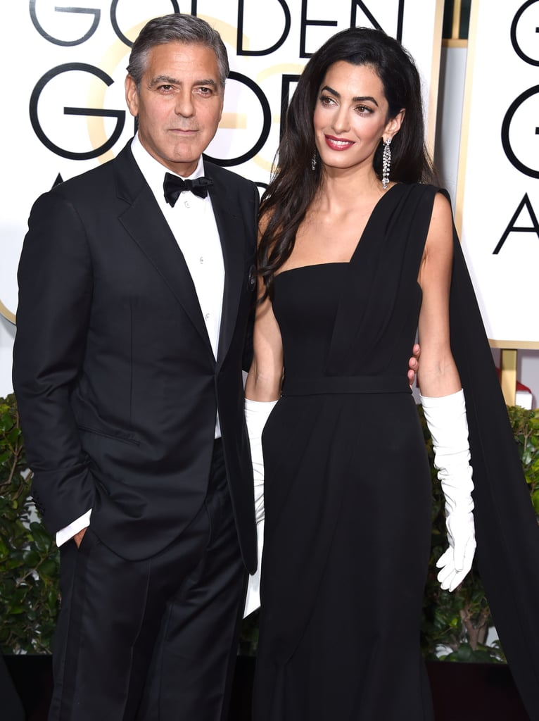 Amal Clooney Golden Globes appearance marked her very first award show, and she was sweetly hooked onto the arm of her handsome husband, George Clooney.
