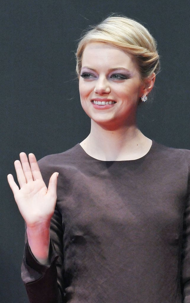 She accented her chic brown dress with diamond stud earrings and a dark smoky eye.