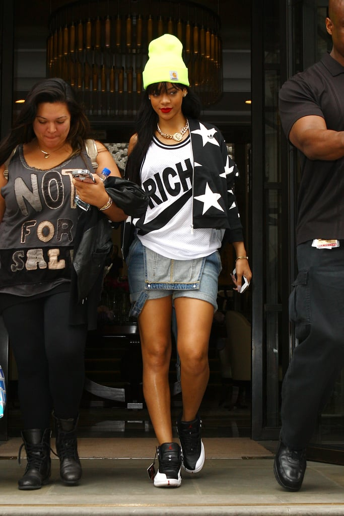 While departing London's Corinthia Hotel, Rihanna married rival sporting brands with an Adidas jacket, a Joyrich jersey, and Nike Air Jordans.