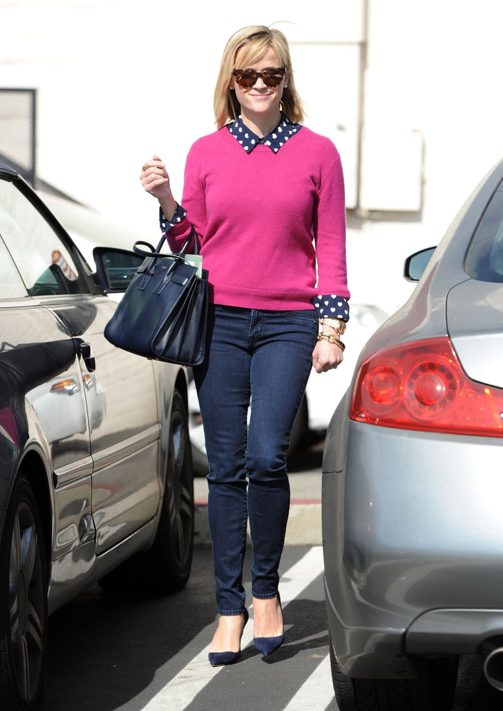 We'll be channeling Reese's about-town look next Valentine's Day. From her heart-print Topshop blouse and lovely pink sweater to her navy suede pumps and coordinating tote, Witherspoon has once again delivered a street style ace.