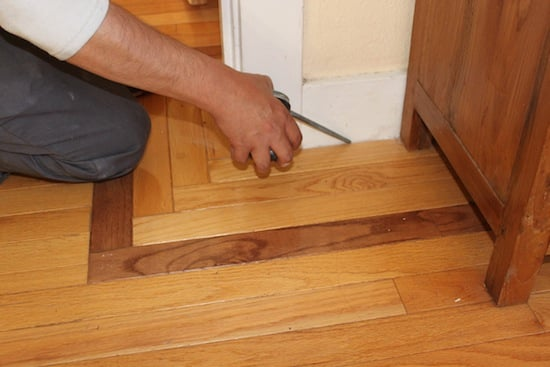 Here you can see him applying it to the baseboards.