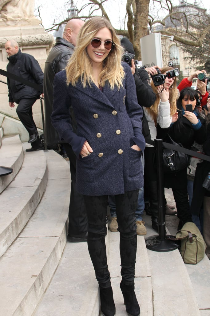 Right outside the Chanel couture show at Paris Fashion Week in January, Elizabeth posed in a military-chic outfit. The round glasses added a bit of quirk to her preppy look.        Longsleeve Tops by Forever 21Boots by Steve Madden