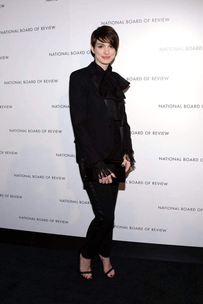 Anne Hathaway did a slick play on menswear in Saint Laurent Spring '13 and a pair of ankle-strap heels.