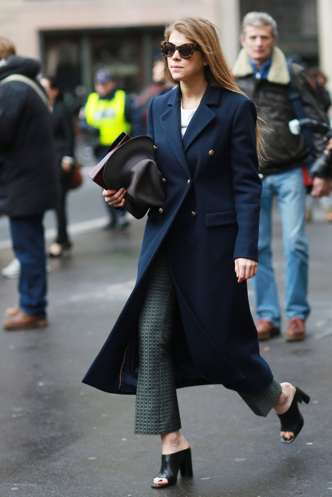 Adding mules to this trouser-and-coat combo makes it all feel a little more nonchalant and not quite so buttoned up.  Source: Tim Regas