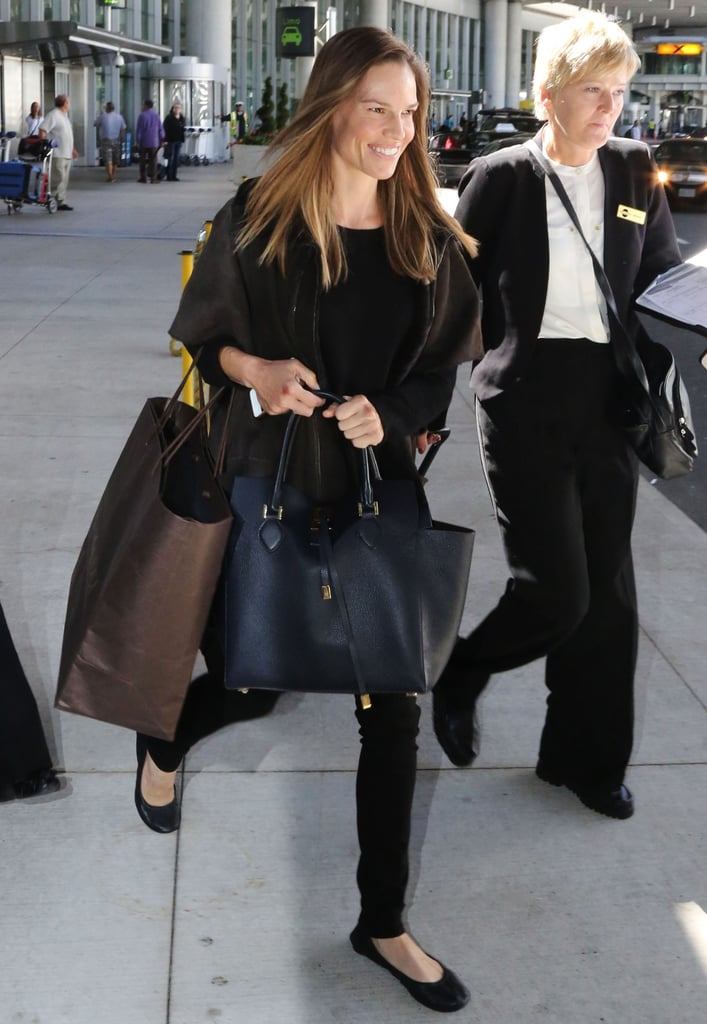 Hilary Swank was sleek in all black while arriving at the airport in Toronto.