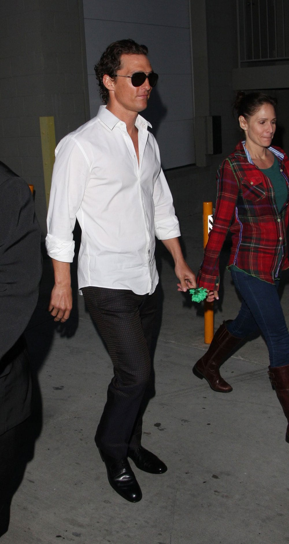 Matthew McConaughey held a green carnation after a taping of Jimmy Kimmel Live in LA on St. Patrick's Day in March 2011.