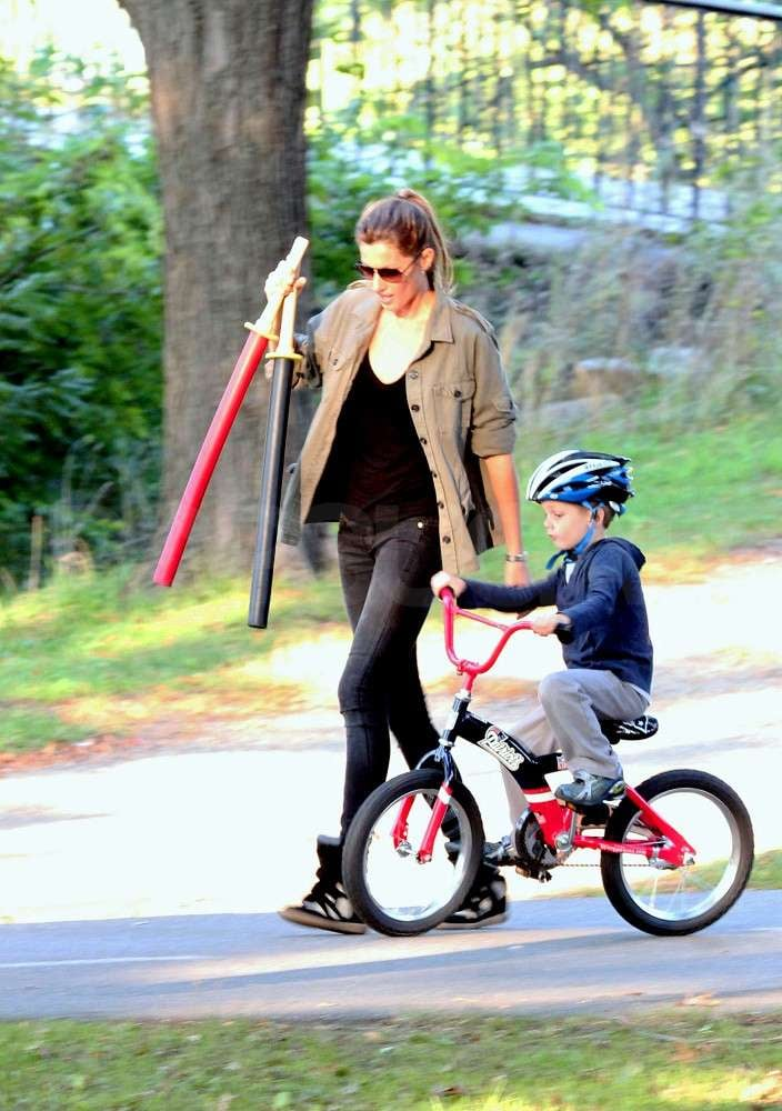 Gisele Bundchen walked next to Jack Brady on a bike.