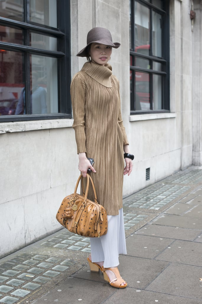 This showgoer outfitted a long skirt with an elegant coat and wide-brim hat for a truly ladylike effect.