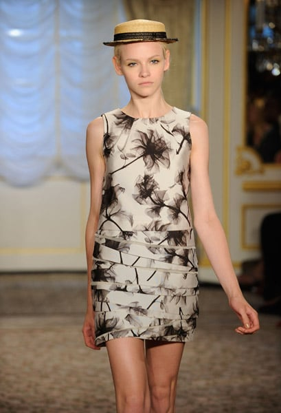 Wu's prints are always interesting, never overdone. We're especially loving the asymmetrical tiered skirt detail.
