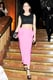 Rose McGowan's pink midi skirt and black crop top made a fabulous duo at the Stefano Tonchi and Craig McDean cocktail party in NYC.