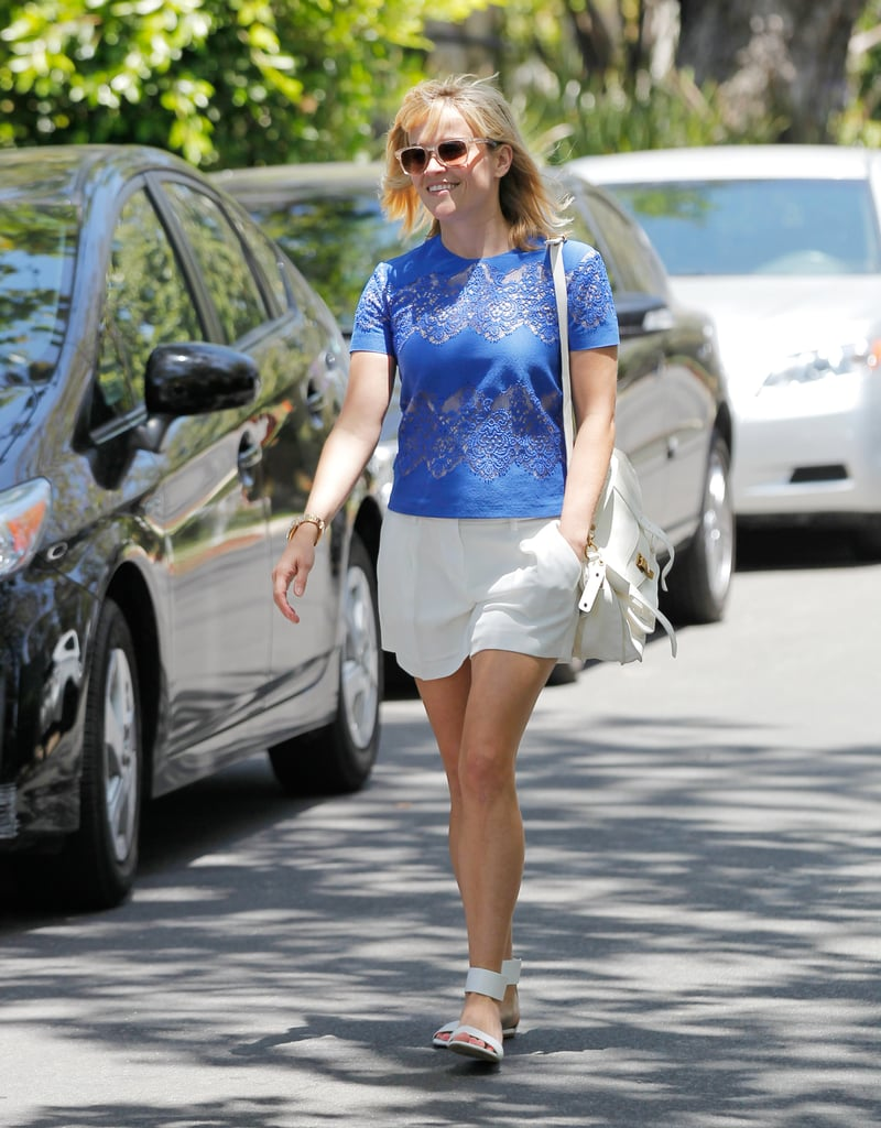 Witherspoon injected a splash of color and flair to her crisp LA look via a cobalt Lover top and glitter Carrera by Jimmy Choo shades.