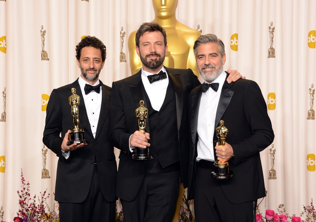 Grant Heslov, Ben Affleck and George Clooney posed with their best picture Oscars.