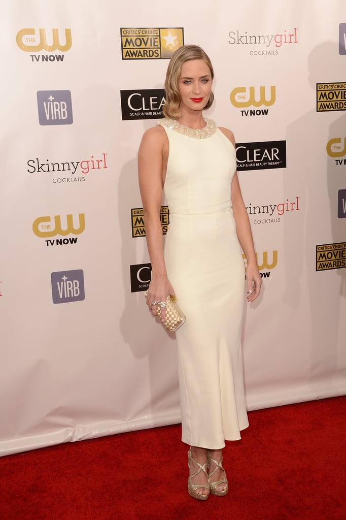 Emily Blunt paired her white Emilio Pucci dress with bright lips on the red carpet.