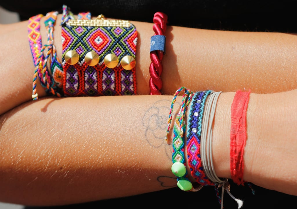Well-armed wrists: covered in stacks of beaded and embroidered friendship bracelets.
