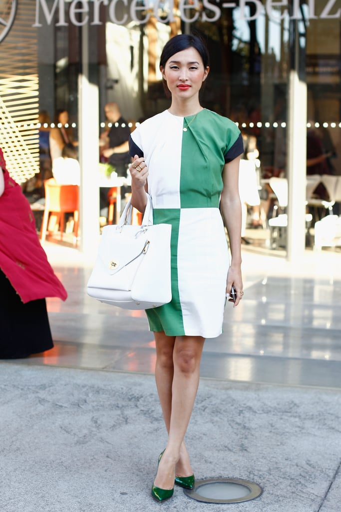 Nicole Warne gave colorblocking a posh twist with a fitted sheath and a sleek white tote in tow.