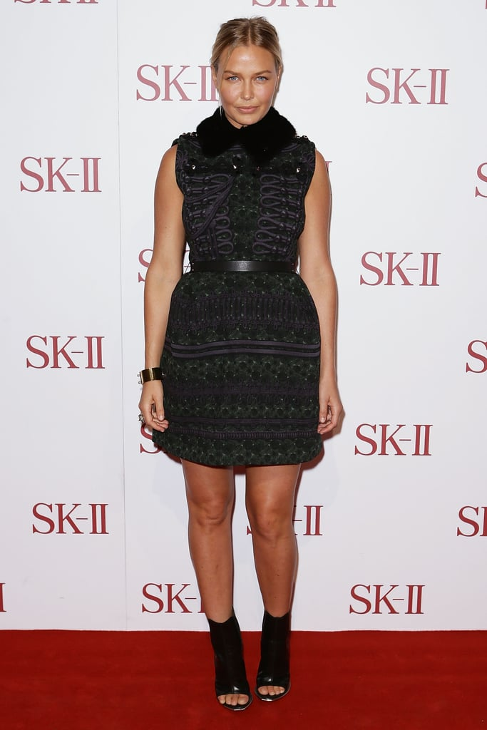 Lara Bingle went dark and dramatic on the red carpet as she attended the SK-II event in Sydney on October 11.